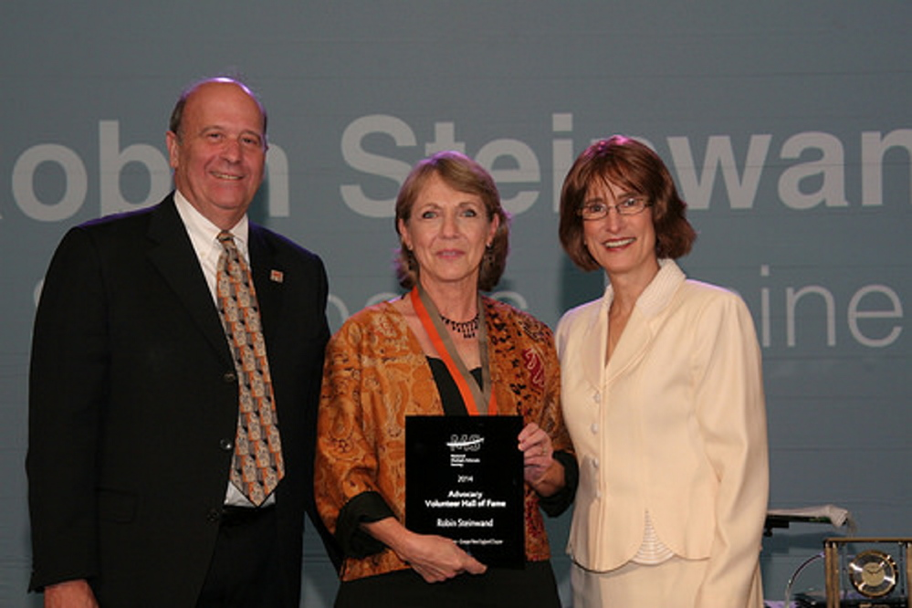 Robin Steinwand, center, at her induction into the National MS Society Volunteer Hall of Fame. From left are Eli Rubenstein, chairman of the National MS Society Board of Directors and vice chair of the Greater New England Chapter, Steinwand, and Cindi Zagieboylo, president and CEO National MS.