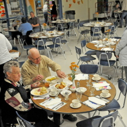 Jean and Harvey Williams, of North Anson, enjoy a Thanksgiving dinner Tuesday at Madison Area Memorial High School in Madison.
