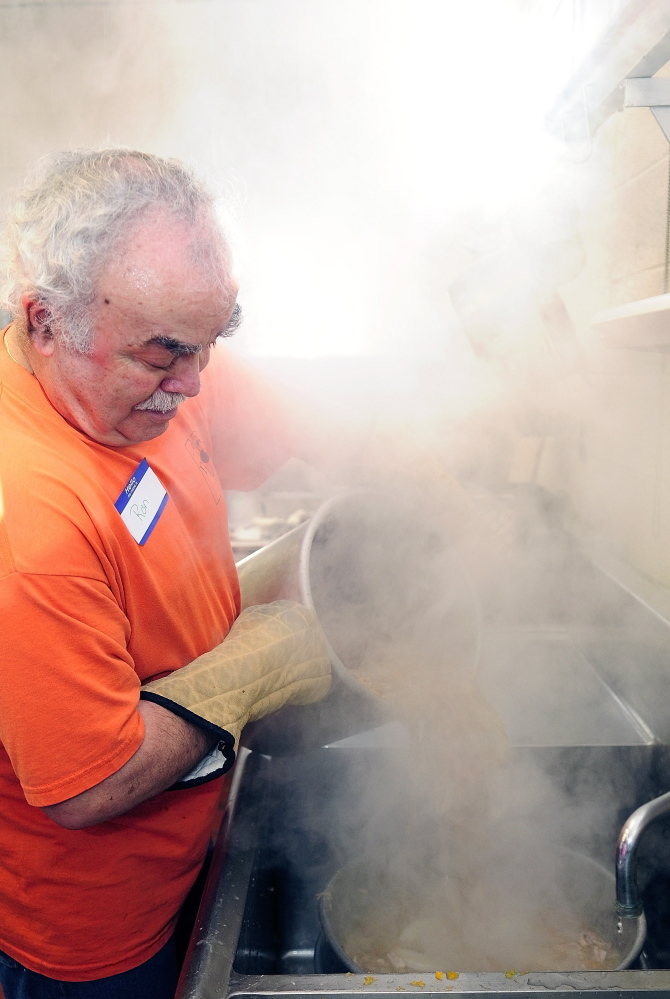 Steam swirls around Ron Emery as he pours a pot of broth through a colander while making gravy for a community Thanksgiving dinner Thursday at Gardiner Area High School.