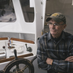 Tim Tower gives an interview Wednesday on his boat in York. Tower uses the boat to charter recreational deep-sea fishing trips. Additional federal fishing regulations have been put on cod, prohibiting recreational fishermen from keeping any cod they catch.