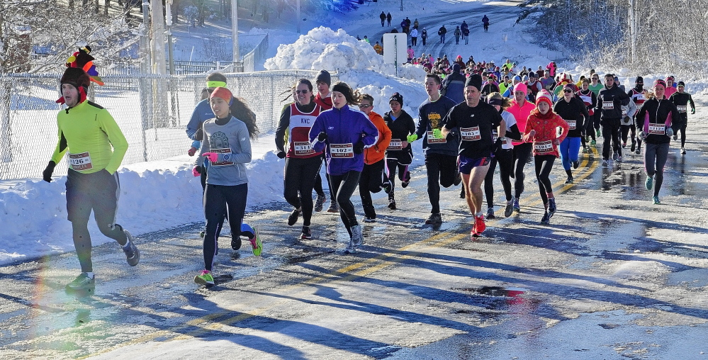 Runners head north on Pierce Drive at the start of the Gasping Gobbler 5k race on Thursday at Cony High School in Augusta.