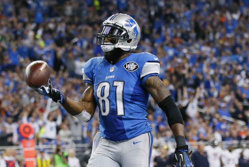Detroit Lions wide receiver Calvin Johnson tosses the ball after his 25-yard reception for a touchdown during the first half Sunday against the Chicago Bears in Detroit. Johnson had 11 receptions for 146 yards and the Lions won 34-17