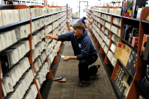 Scott Bennett of Litchfield browses the music section at Bull Moose in Waterville during the afternoon on Black Friday.