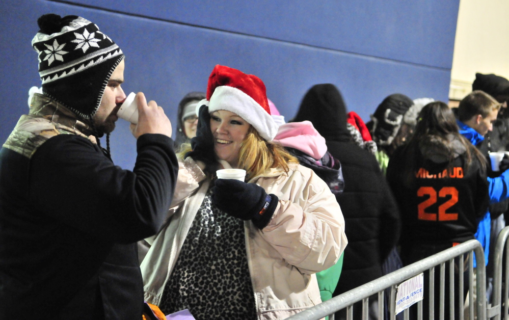 John and Rhonda Brann sip hot chocolate as they wait in line  at 11:24 p.m. on Thursday November 27, 2014 at Best Buy in Augusta.