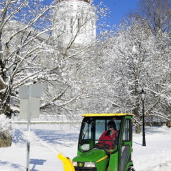 Richard Lachance Jr. runs a tractor with a snowblower along the sidewalk in front the Maine State House on Thursday after an overnight snow storm in Augusta. He and other Bureau of General Services workers spent their Thanksgiving mornings clearing snow from around state government buildings.