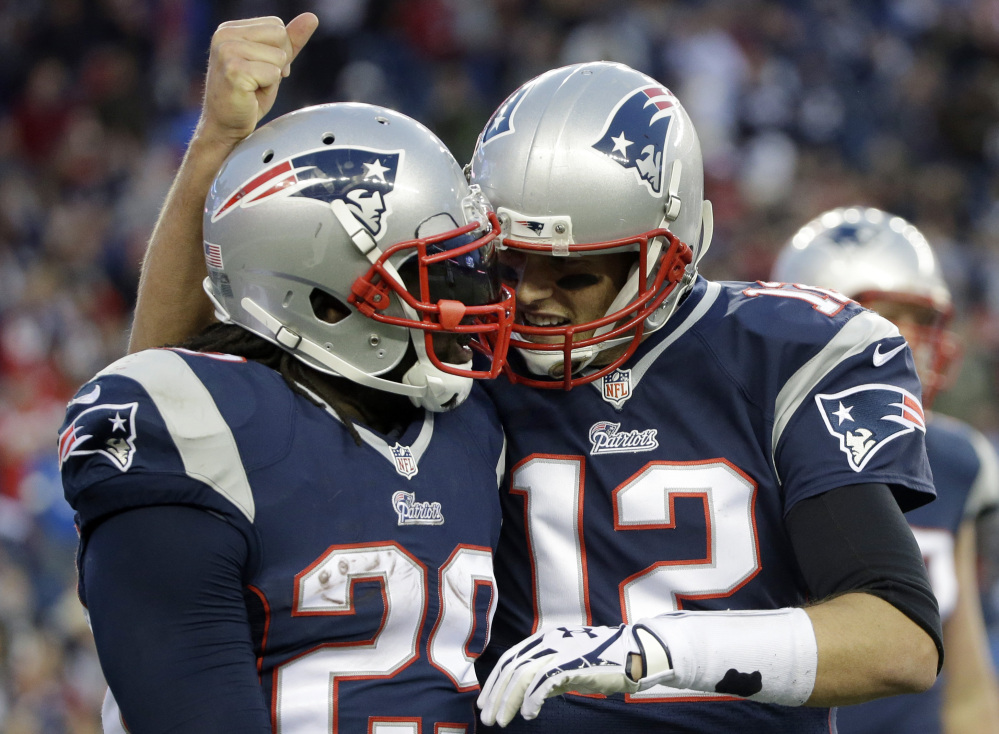 New England Patriots quarterback Tom Brady, right, congratulates running back LeGarrette Blount on his touchdown in the fourth quarter last Sunday against the Detroit Lions in Foxborough, Mass. The Patriots play the Green Bay Packers on Sunday at Lambeau Field in Green Bay, Wisc.