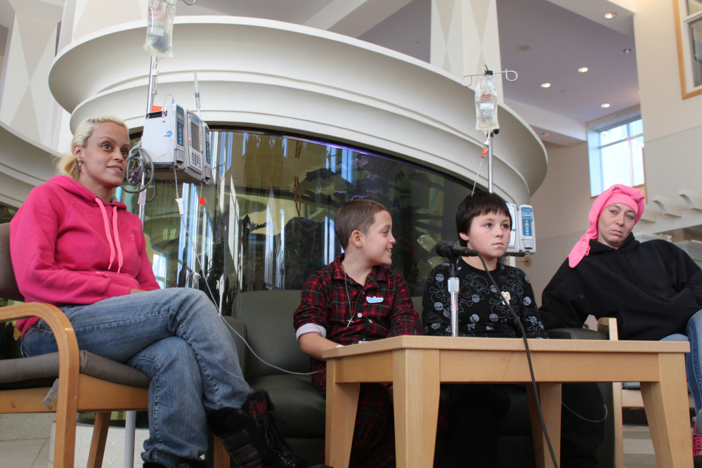 Nine-year-old Jason Rivera, center left, and Elijah Martinez, 11, center right, are joined by their mothers, Aulix Martinez, left, and Deirdre Kirk during a news conference Friday at Westchester Medical Center's Maria Fareri Children's Hospital in Valhalla, N.Y.