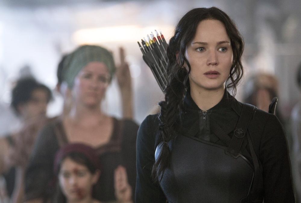 """In this image released by Lionsgate, Jennifer Lawrence portrays Katniss Everdeen in a scene from """"The Hunger Games: Mockingjay Part 1."""""""