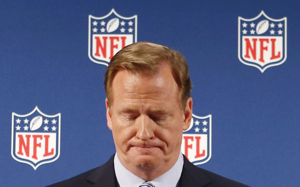 In this Sept. 19, 2014, file photo, NFL Commissioner Roger Goodell pauses as he speaks during a news conference in New York.