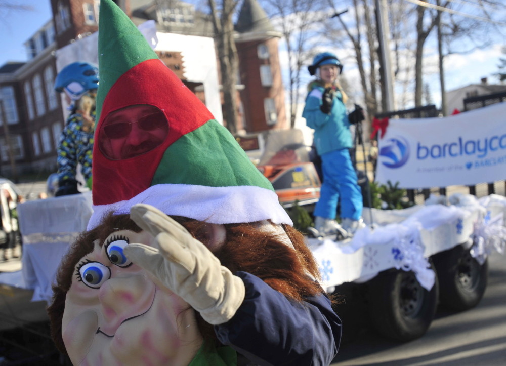 Dan Farrington, dressed as an elf, waves to the crowd on Main Street during the annual Chester Greenwood Day parade in downtown Farmington in December 2013.