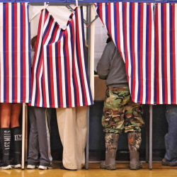 Voting booths were all full and there was a line out of the gym on Tuesday, Nov. 4, 2014, at Hall-Dale Middle School in Farmingdale. (Photo by Joe Phelan/Staff Photographer)