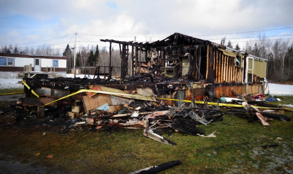 A home at the Westgate Mobile Home Park in Caribou was destroyed by fire Thursday. A woman and three young children died in the fire reported around 7 a.m.