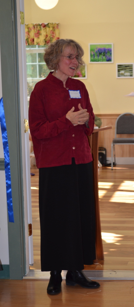 Margaret Godfrey listens to her daughter, Jill Godfrey, give a speech at the Sunset Home's recent 90th anniversary celebration.