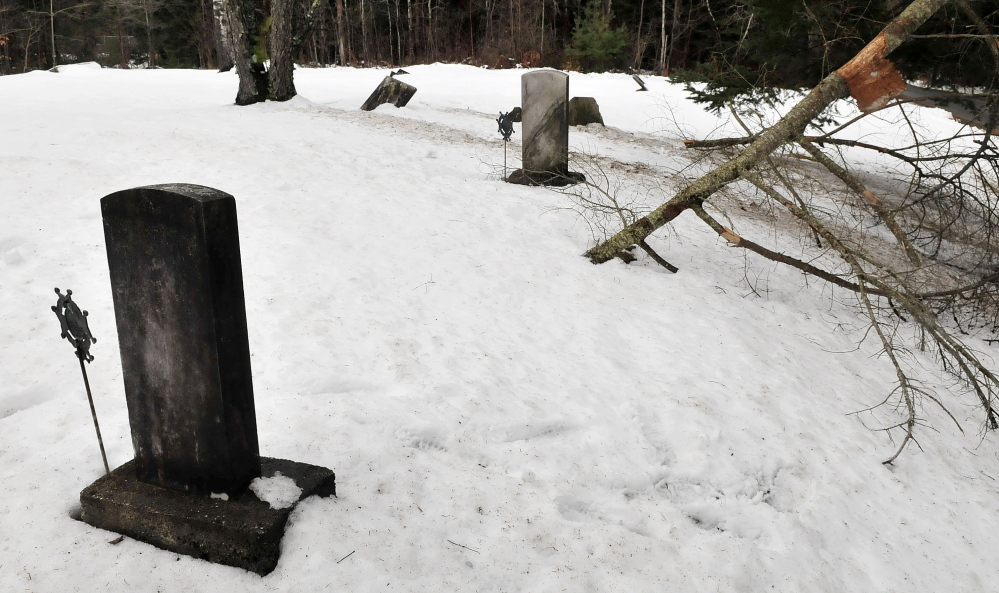 Fallen trees and listing gravestones are evident at the Red Schoolhouse cemetery in Farmington where selectmen have accepted a plan by volunteers to repair the Revolutionary War era cemetery.