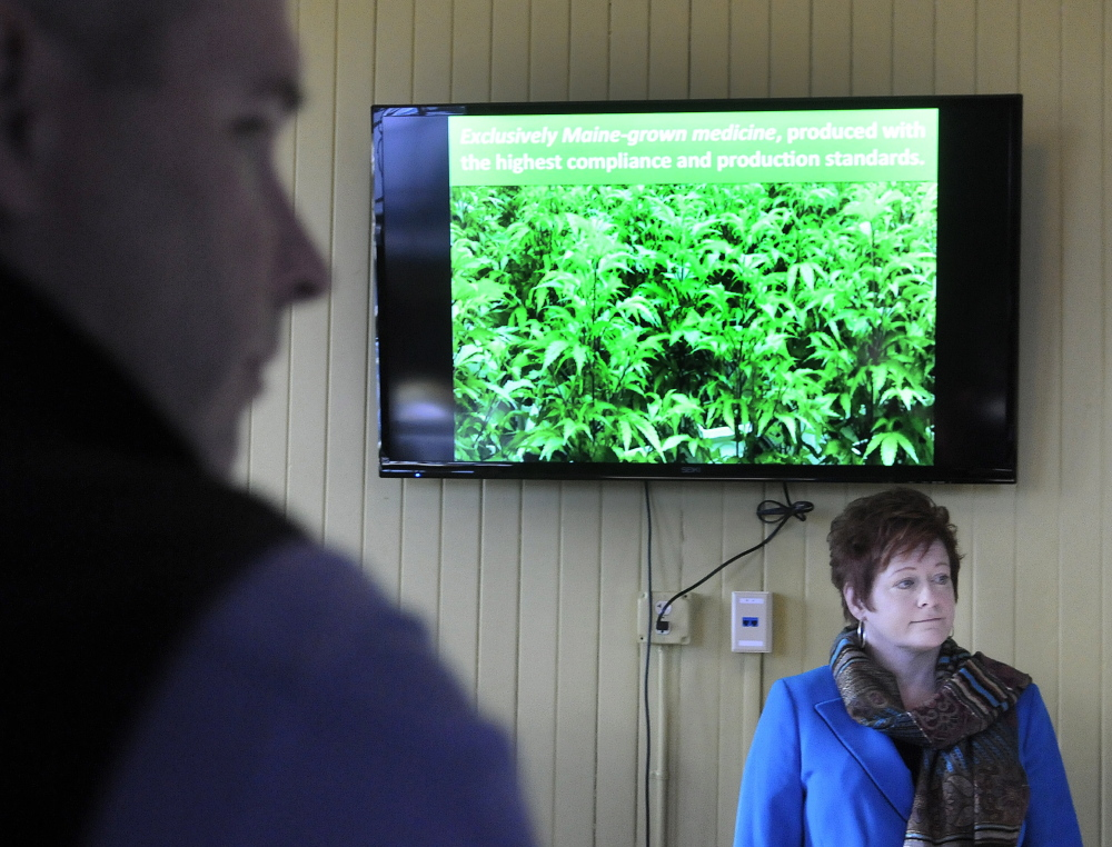 Becky DeKeuster gives a tour Monday of one of the two rooms that was open to visitors at the Wellness Connection of Maine's new dispensary at the historic train station in Gardiner. DeKeuster is the co-founder of Wellness Connection of Maine.