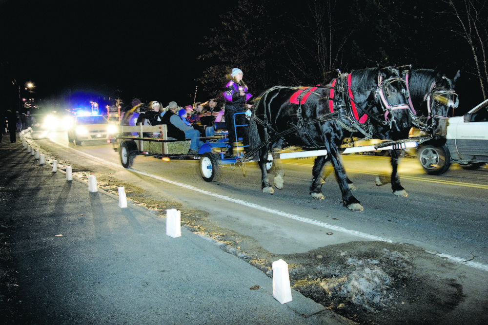 Wagon rides, like this one several years ago, will be a feature at the Belgrade Village Holiday Stroll again Saturday.