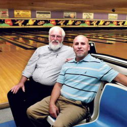 Sparetime Recreation bowling alley owner Andy couture, left, and the Rev. Craig Riportella of the Centerpoint Community Church sit at the Waterville bowling alley last September. The city solicitor has ruled no zoning change is needed to allow the church to buy the bowling alley property.