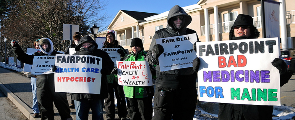 Bundled up against single digit temperatures, strikers picket Tuesday outside a health care conference sponsored in part by FairPoint Communications. Union workers across New England went on strike against the telecommunications firm on October 17 after the company imposed higher health insurance premiums, according to a release from the International Brotherhood of Electrical Workers, which represents many of the FairPoint employees.  The conference, organized by the Maine State Chamber of Commerce, at the Senator Inn will focus on the Affordable Care Act.