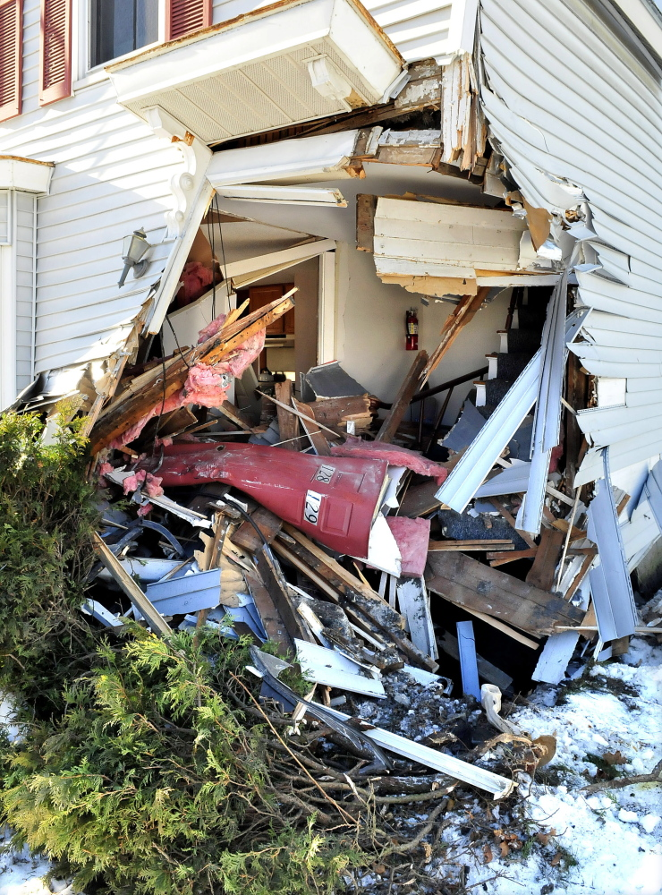 The damage left on a home on Madison Avenue in Skowhegan after a tractor trailer struck the building on Tuesday.
