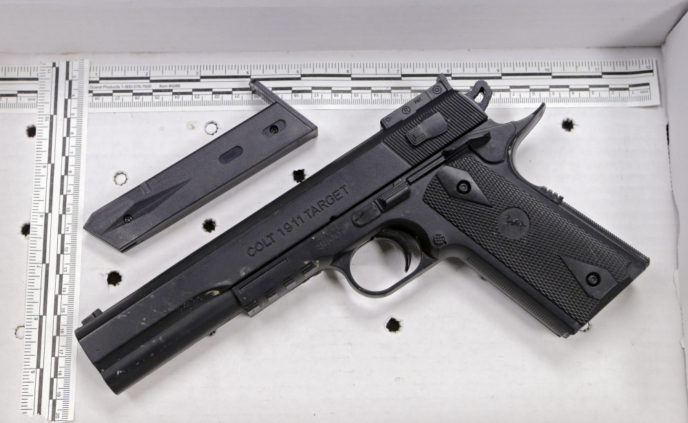 This fake handgun taken from 12-year-old Tamir Rice, who was fatally shot by Cleveland police over the weekend, is displayed after a news conference Wednesday, Nov. 26, 2014.