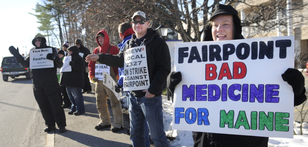 Krista MacKay of South Gardiner, right, holds a sign while picketing Tuesday outside a health care conference in Augusta sponsored in part by FairPoint Communications. Union workers across New England went on strike against the telecommunications firm on October 17 after the company imposed higher health insurance premiums, according to a release from the International Brotherhood of Electrical Workers, which represents many of the FairPoint employees.