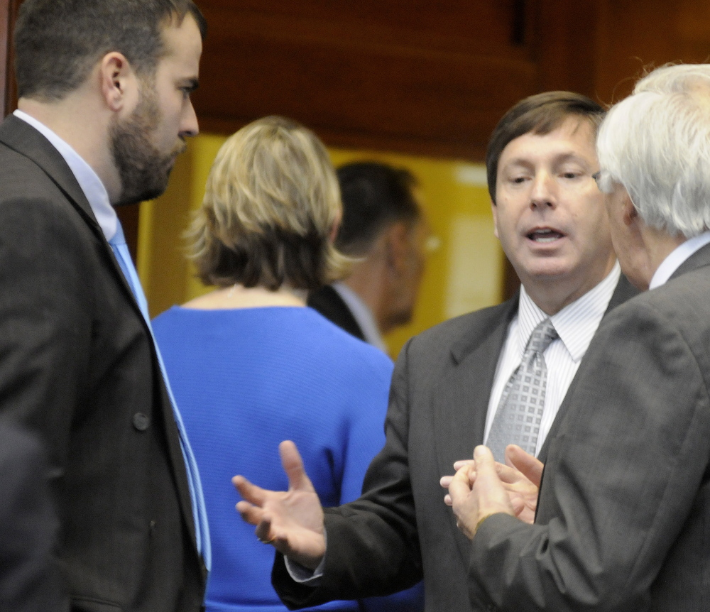 Republican Minority Leader Rep. Ken Fredette of Newport argues with Democratic Reps. John Martin of Eagle Lake, right, and Jeff McCabe of Skowhegan in the well of the House of Representatives in Augusta.