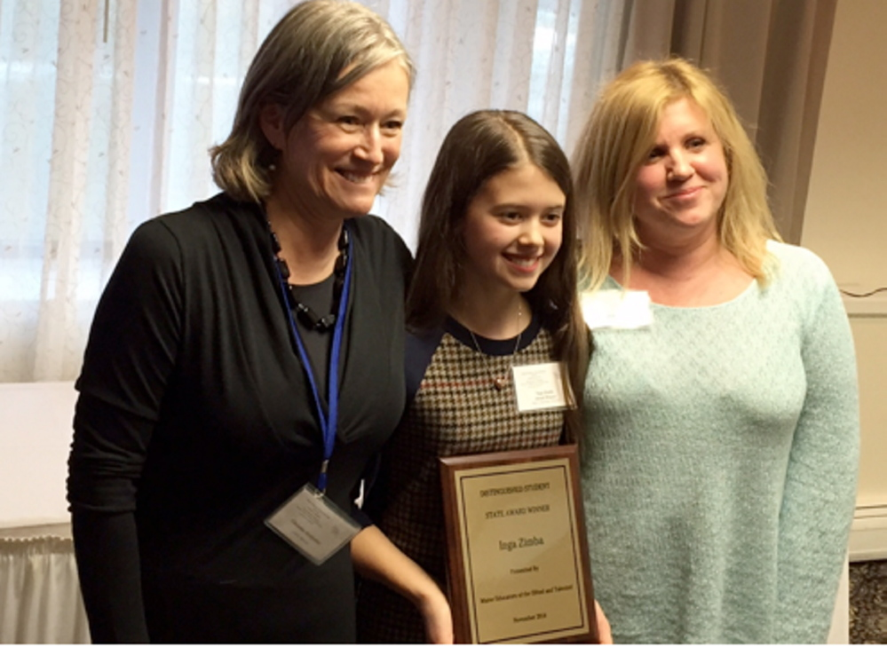 At the MEGAT Awards Banquet, from left, are Tina Serdjenian, teacher of K-5 gifted and talented students, Inga Zimba, and Hollie Hilton, Hall School art teacher.