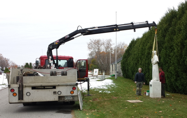 The Italian marble statue of Elizabeth Ann Seton which stood in the courtyard of MaineGeneral's Seton campus was moved recently to its new home at St. Francis Catholic Cemetery, Grove Street, Waterville. The move was made possible by Rock and Bernice Lacroix of Provost Monuments in Benton. Seton was foundress of the Sisters of Charity, who built and operated the hospital for many years until it became part of MaineGeneral Health. The statue was originally donated to the hospital by Mr. and Mrs. Napoleon Emond, Mr. and Mrs. Everest Laverdiere and Mr. and Mrs. Leo Michaud, all now laid to rest at St. Francis Cemetery.