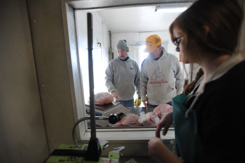 MERCER, MAINE - NOVEMBER 8, 2014.   Scott Greaney, left, talks with a customer on one of the walk-in slaughter days at Greaney's Turkey Farm Saturday, Nov. 8, 2014. Scott has been relegated to customer work and tasks away from the slaughter due to his cancer treatment and compromised immune system. (Staff photo by Michael G. Seamans)