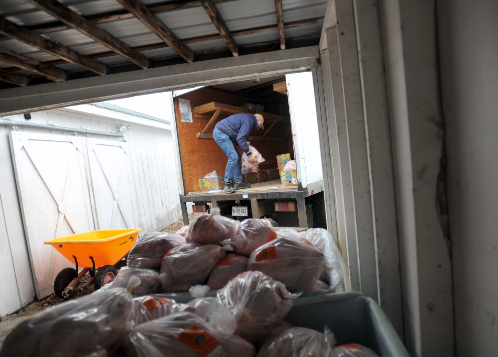 MERCER, MAINE - NOVEMBER 22, 2014.   Bob Spear, owner of Spear's Farm Stand in Waldobor, loads one of the 75 turkeys they bought on to his refrigerated box truck at Greaney's Turkey Farm in Mercer on Saturday, Nov. 22, 2014. The Spears have been purchasing the turkeys for the past six years. (Staff photo by Michael G. Seamans)