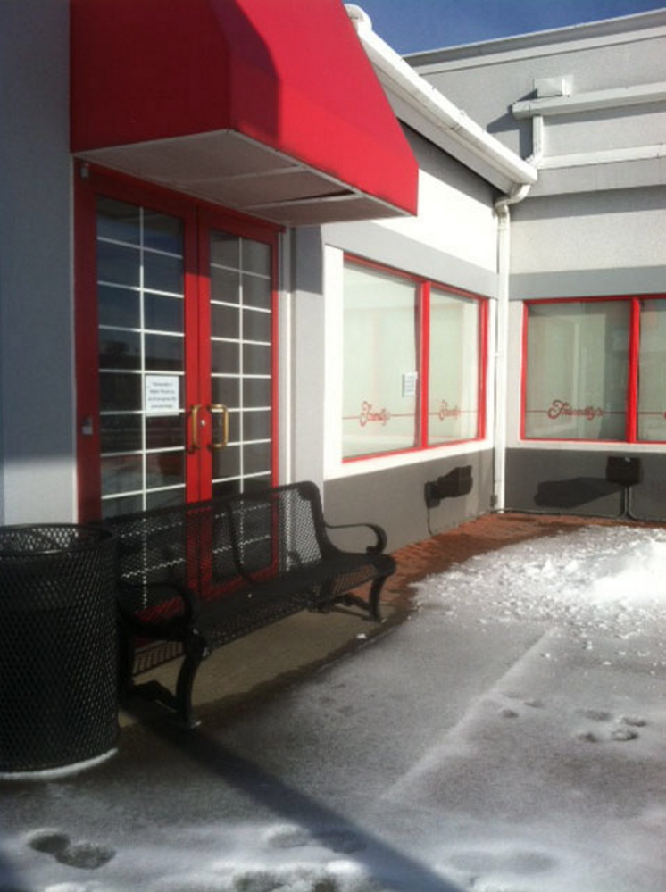 A bench blocks the door at Friendly's at 373 Main St. in Waterville. The restaurant closed suddenly this week.
