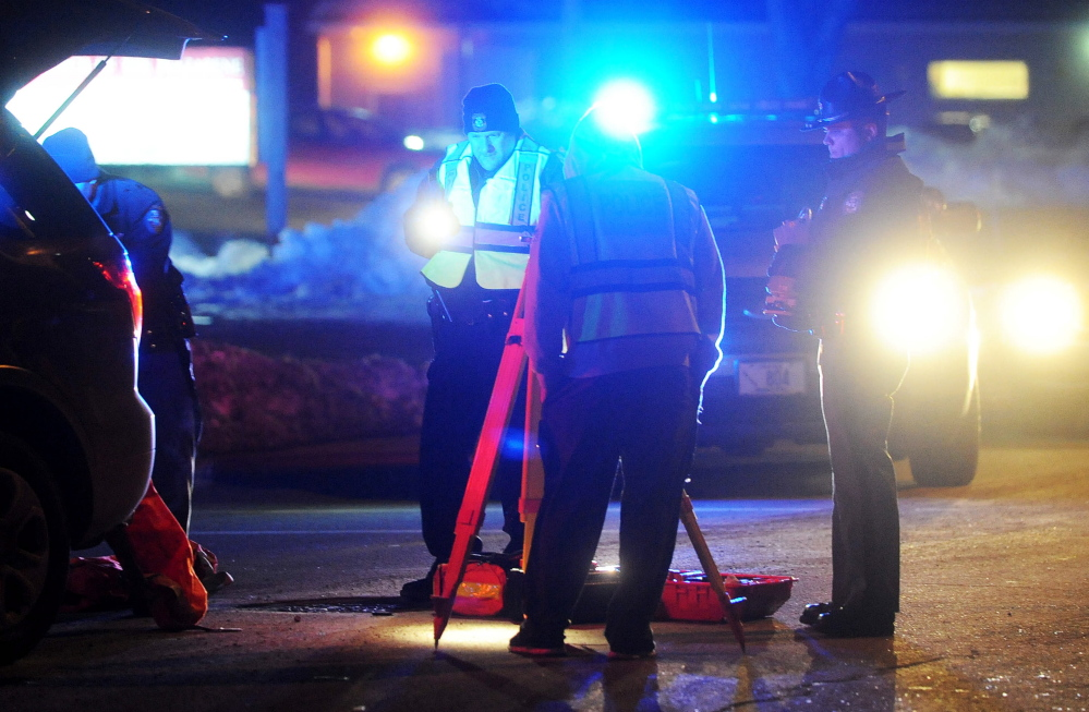 Fairfield police investigate the scene where a man was struck by a Subaru Outback on Main Street in Fairfield on Thursday.