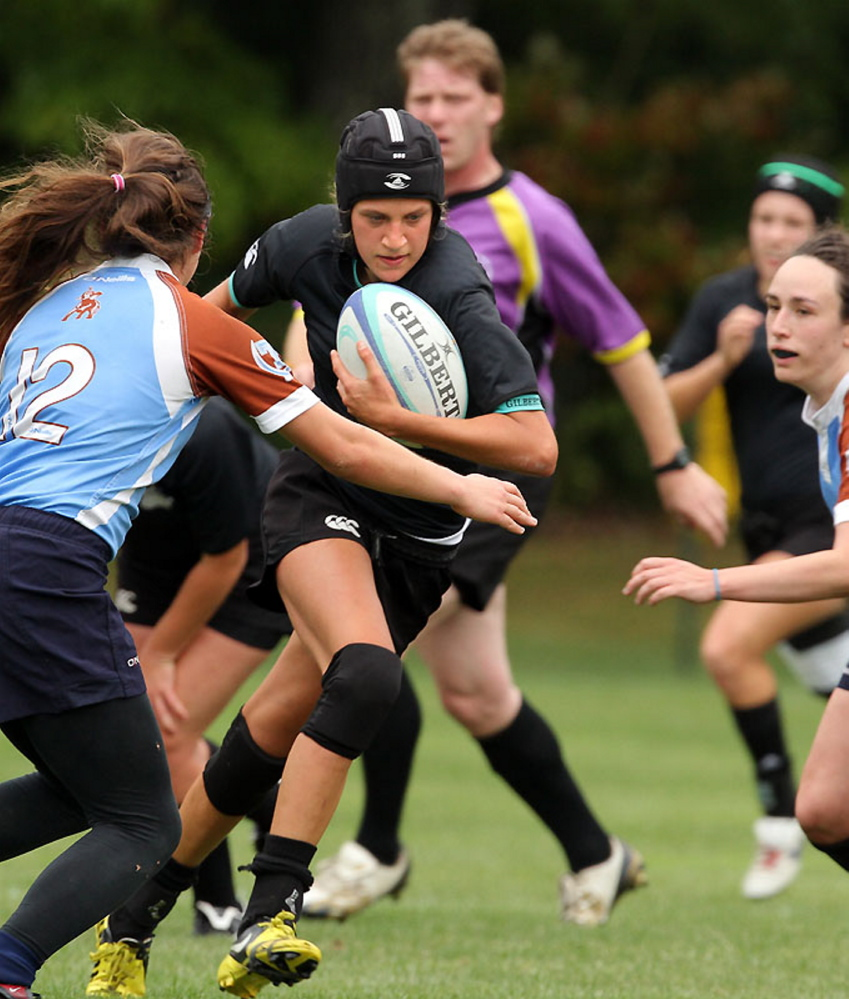 Anna Piotti runs during a recent rugby match for Bowdoin College.
