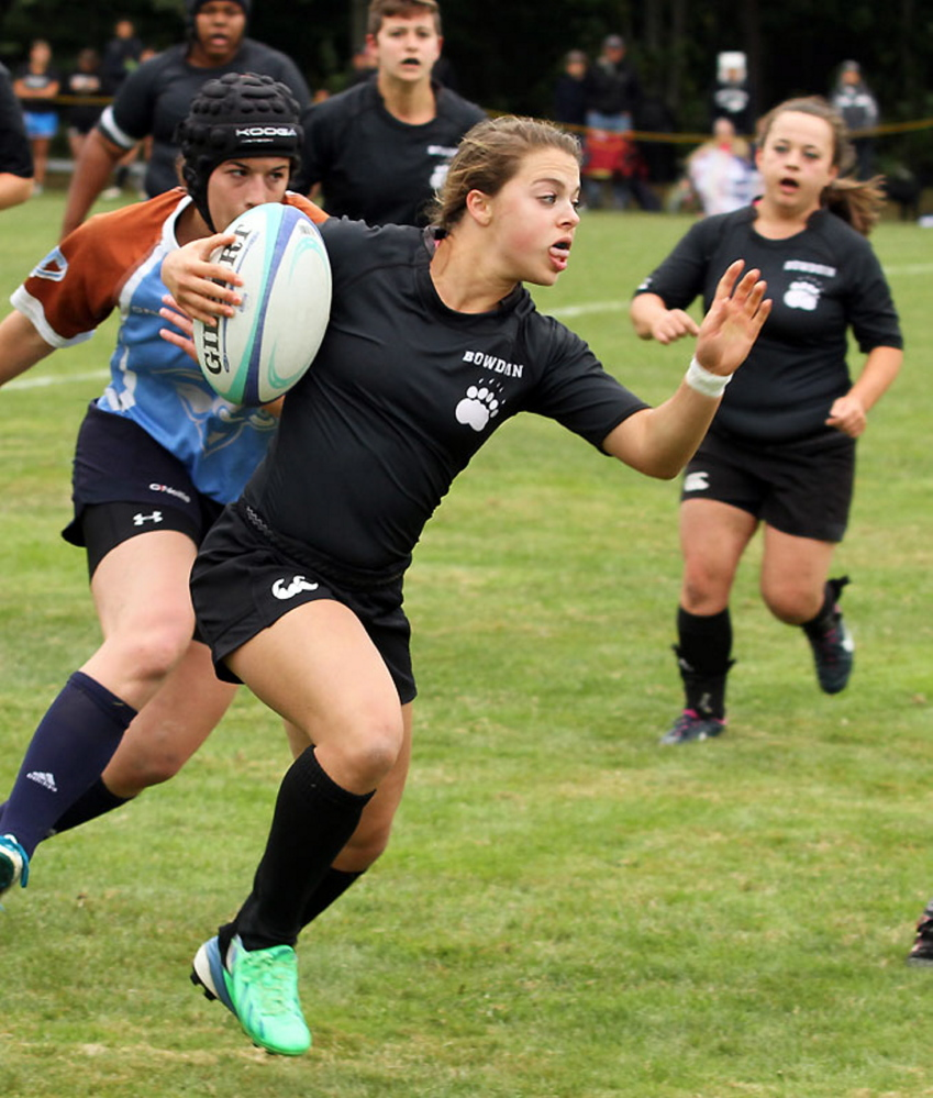 Georiga Bolduc looks for running room during a recent rugby match for Bowdoin College.