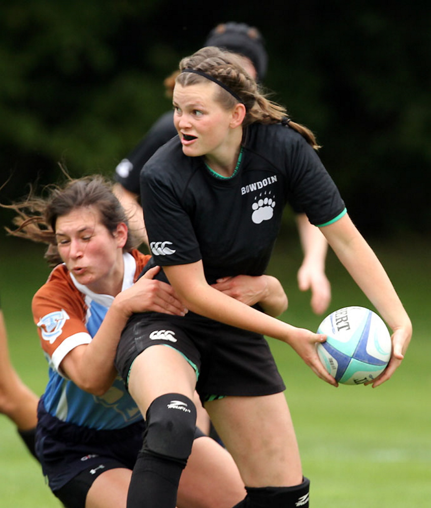 Hayleigh Kein looks to toss the ball during a recent rugby match for Bowdoin College.