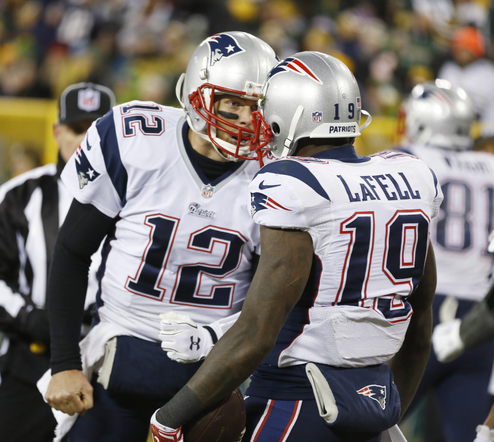 New England Patriots' Tom Brady (12) celebrates Brandon LaFell's touchdown catch during the second half Sunday against the Green Bay Packers in Green Bay, Wis. The Patriots play the San Diego Chargers on Sunday.