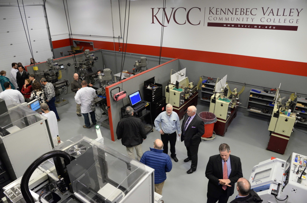 Visitors at an open house in the updated Kennebec Valley Community College precision machining technology laboratory.