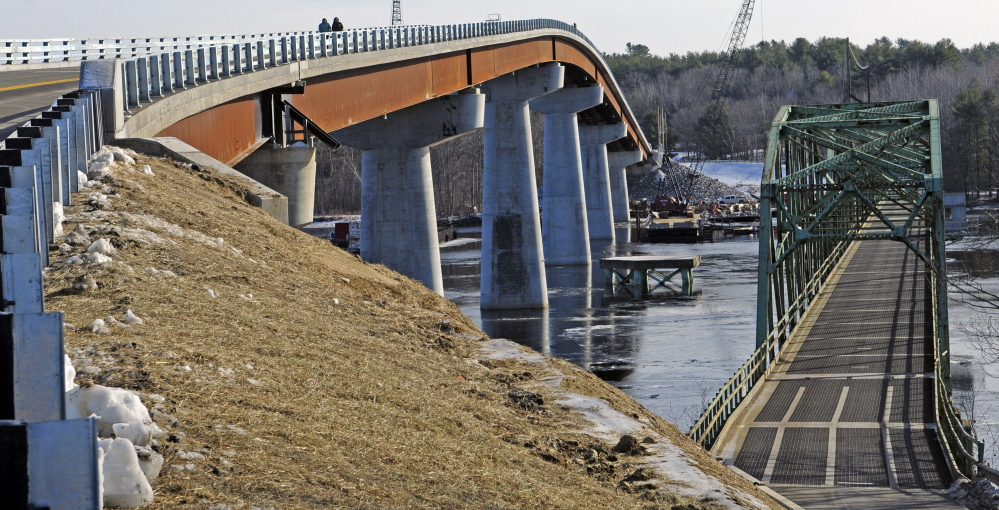 The old bridge is seen, at right, after the opening ceremony on Friday for the new bridge over the Kennebec River between Richmond and Dresden.
