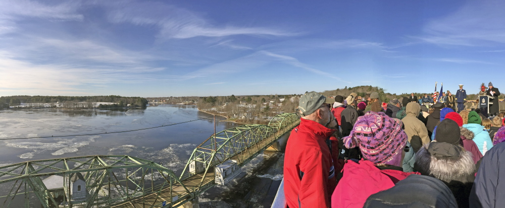 The old bridge is seen in the background during the opening ceremony on Friday for the new bridge over the Kennebec River between Richmond and Dresden.