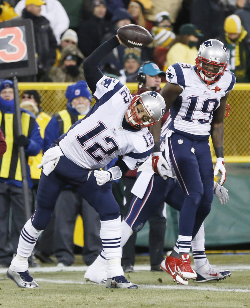 New England Patriots' Tom Brady spikes the ball after throwing a touchdown pass to Brandon LaFell, 19, during the first half last week against the Green Bay Packers. The Patriots play the San Diego Chargers on Sunday night in San Diego.
