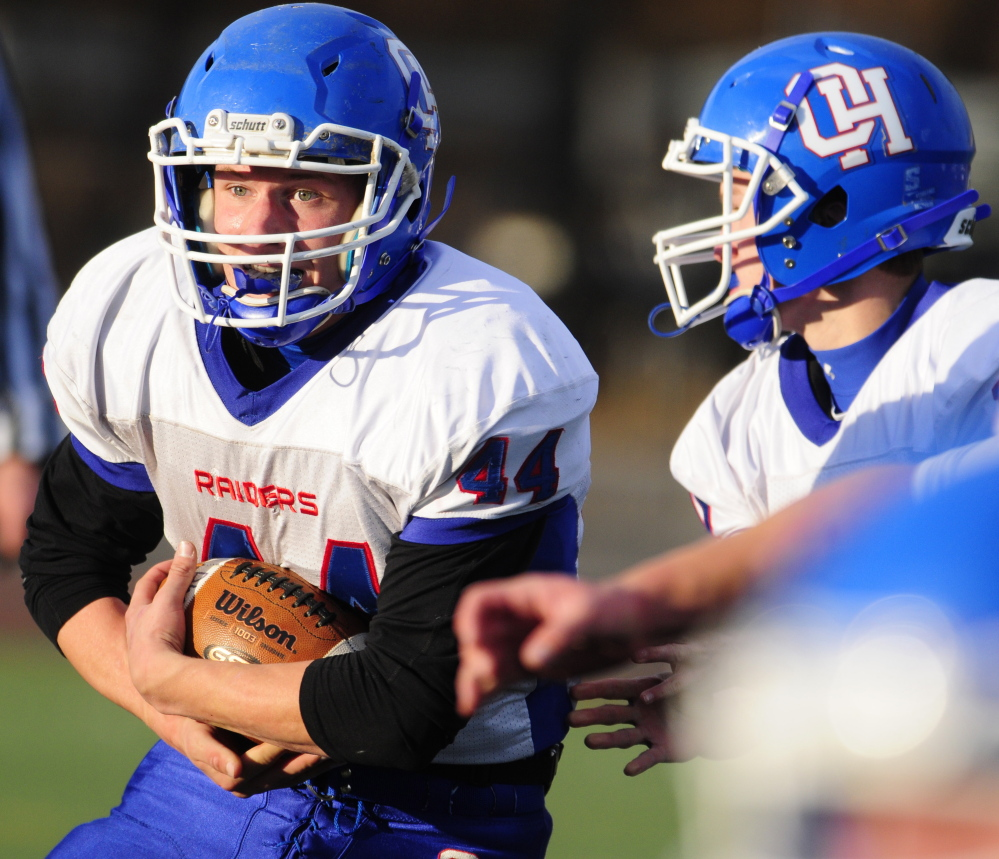 Oak Hill's Kyle Flaherty, left, takes a handoff from quarterback Dalton Therrien during the Class D state game in Portland. Carrier was named a finalist for the Fitzpatrick Trophy Saturday.