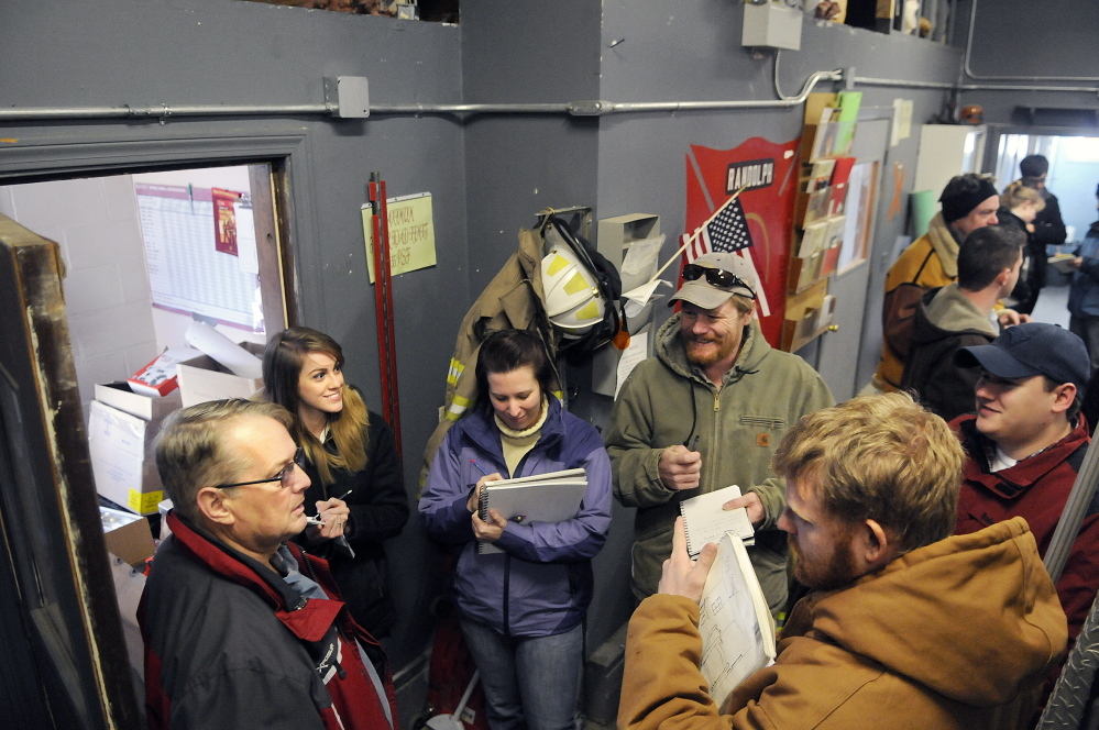 University of Maine at Augusta architecture students interview Randolph Fire Chief Ron Cunningham, left, during a tour of the Randolph fire station on Monday.