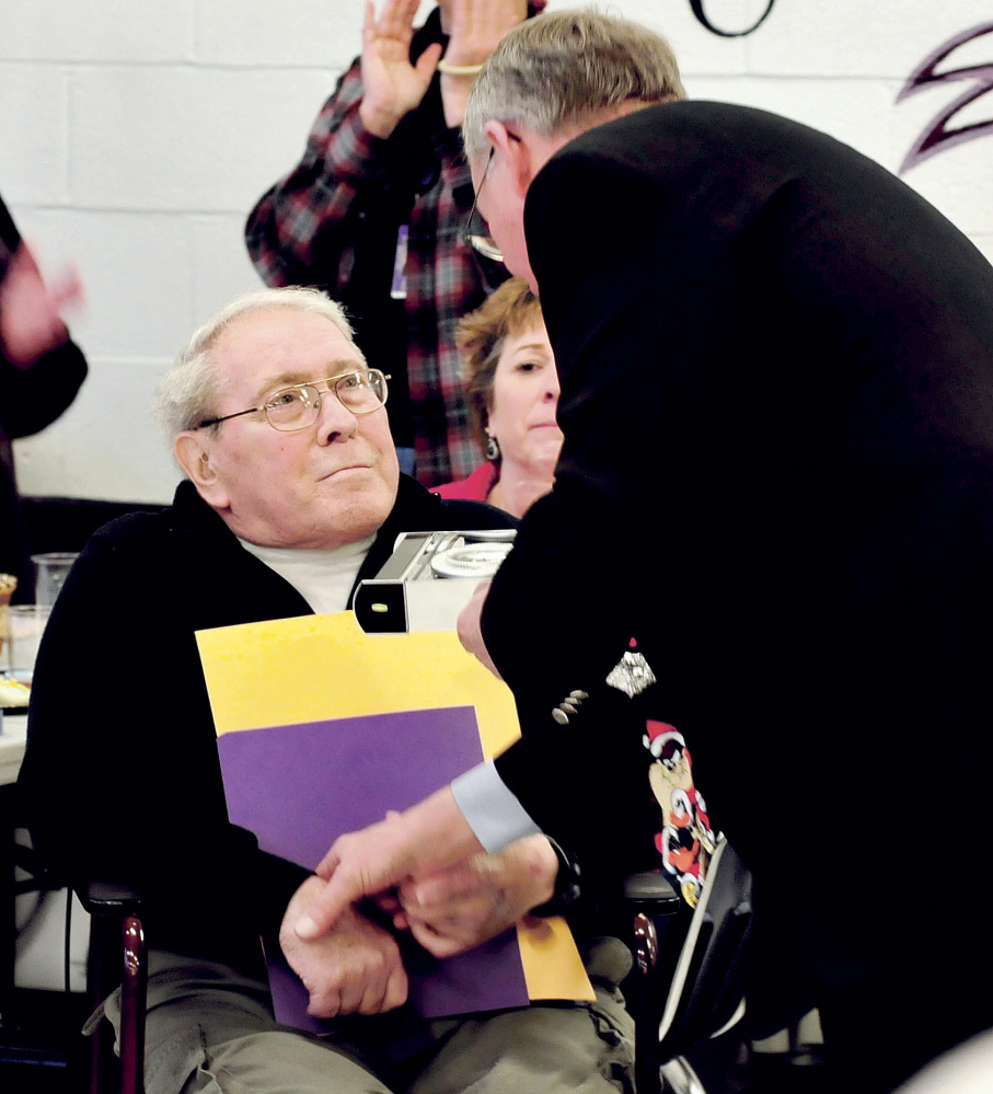 Retiring Waterville School Board member and chairman Lee Cabana shakes hands with Superintendent Eric Haley as he was honored for more than 50 years service to local schools on Monday