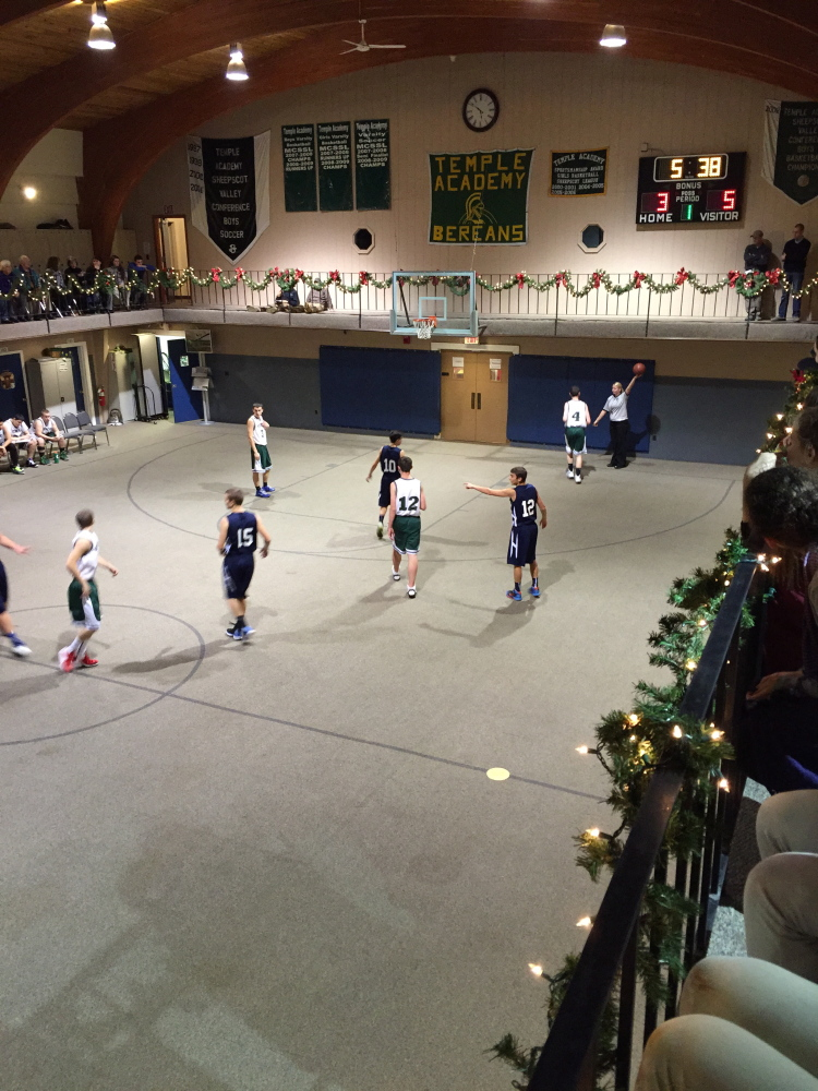 Temple Academy played its first basketball games Monday as members of the Maine Principals' Association.