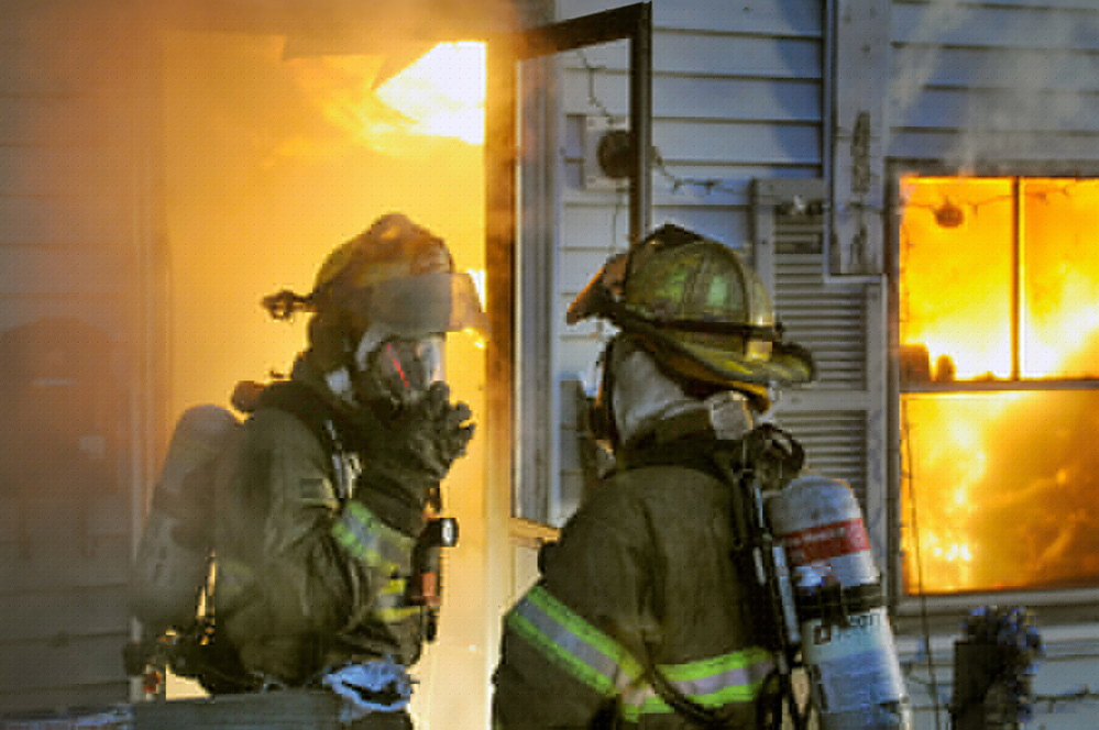 Firefighters battle a blaze at an apartment on State Street in Augusta Tuesday morning.