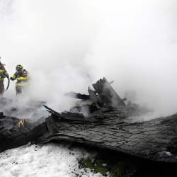 Firefighters search for hot spots Tuesday inside a South Gardiner barn that collapsed after catching fire in the afternoon. Owner Hope Olivencia said she lost some possessions belonging to her mother, who just relocated to South Gardiner, but she is grateful nobody was injured and her home was not damaged.