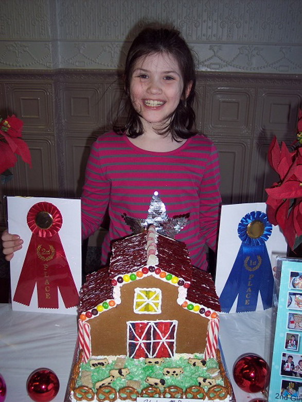 Haley McFadyen, of North Anson, won Professional and People's Choice in children 5-8 years old category, for her barn and cows.