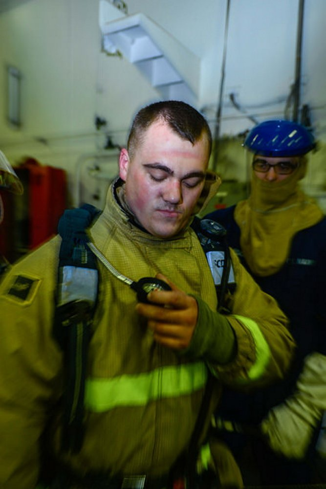 Contributed photo Damage Controlman Fireman Sean Cote, from Winslow, Maine, checks his air time indicator after a fire drill aboard Nimitz-class aircraft carrier USS John C. Stennis (CVN 74) in the Pacific Ocean. Stennis is currently undergoing an operational training period in preparation for future deployments, according to a news release from the U.S. Navy.