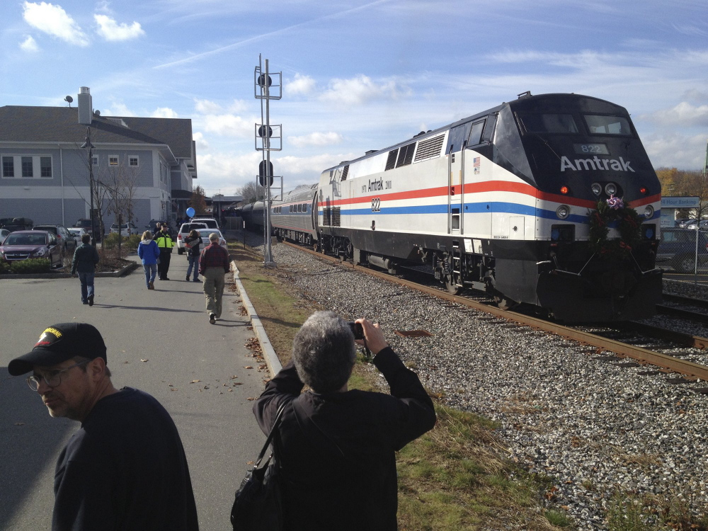 The Downeaster pulls into Brunswick Station while on its inaugural run north of Portland to Freeport and Brunswick in this 2012 file photo. Rail advocates say they would like to extend the line from Brunswick to Augusta.