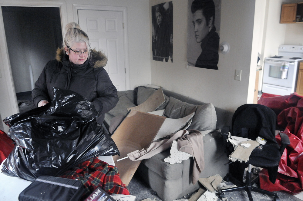 Sarah Holland packs up her belongings Wednesday after her apartment on State Street in Augusta was destroyed in a fire Tuesday. Holland said she's looking for an apartment to enable her to work and go to school.